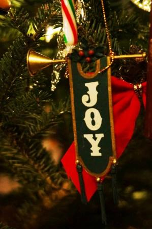 Christmas decoration with joy written on it.