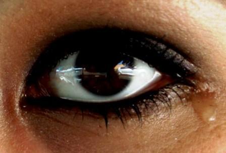 a brown eye, weeping