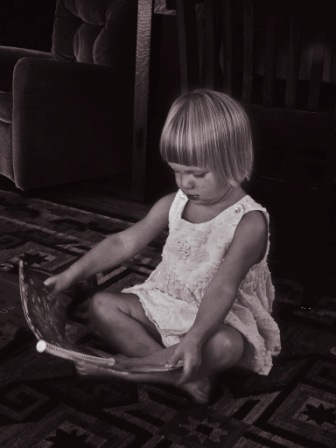 a little girl reads a book