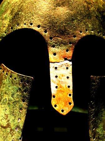 Close up a battered ancient helmet