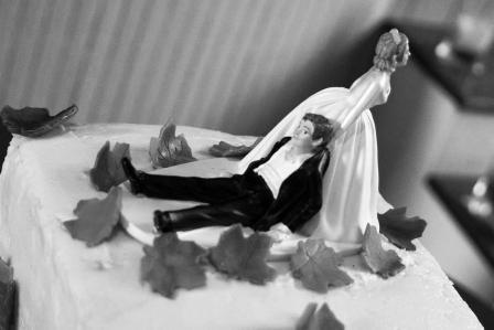 a model bride drags her groom  across the cake