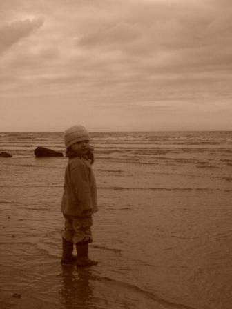 image of a child at the beach