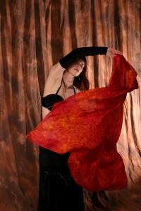 A bellydancer swirls her veil
