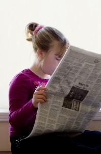 girl-reading-paper