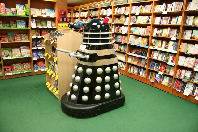 A dalek browsing the children's books on the ground floor of Waterstones LinkExternal link unable to get upstairs for a cup of coffee or reach the travel books ! © Copyright Richard Croft and licensed for reuse under this Creative Commons Licence