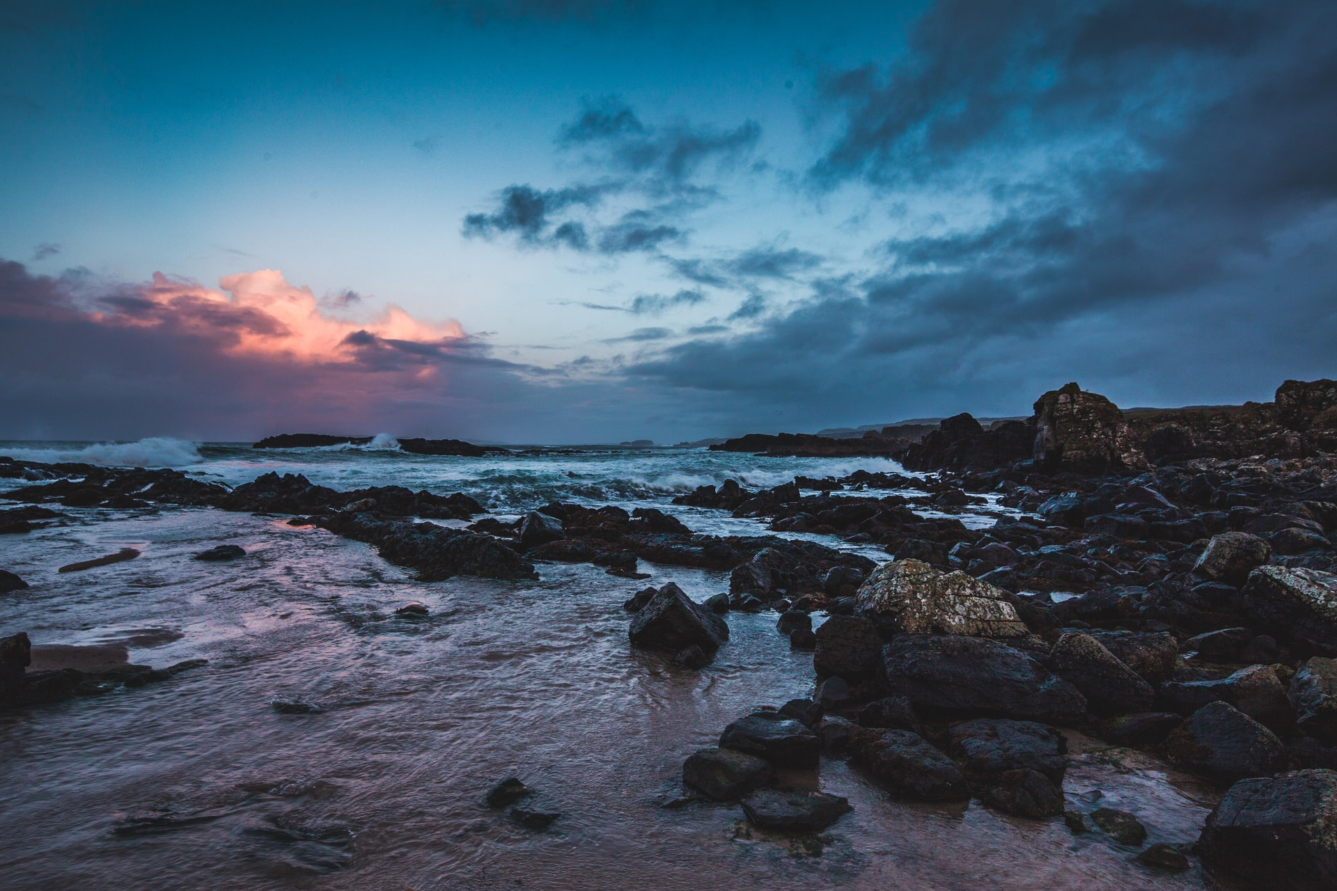 sunrise over a rocky seashore